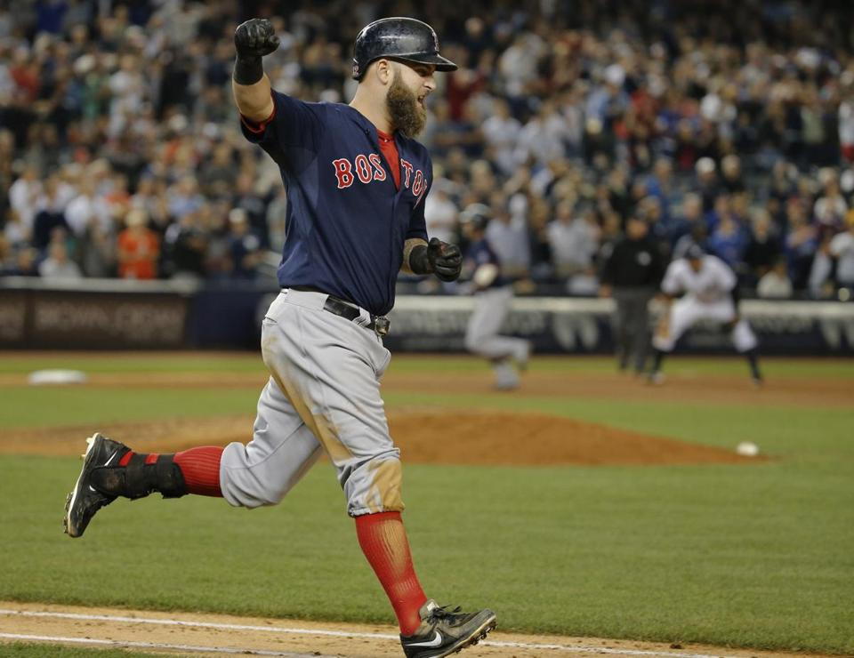 Mike Napoli celebrated after hitting a grand slam against the Yankees in the seventh inning.