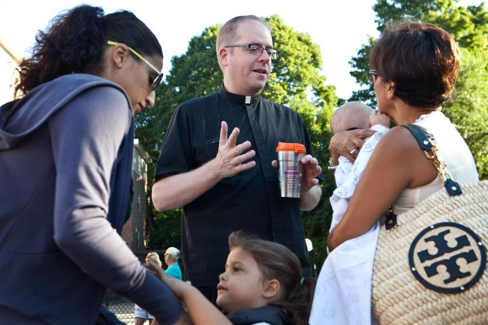 The Rev. Sean Connor spoke with parents at Sacred Heart Elementary inWeymouth on the first day of school.