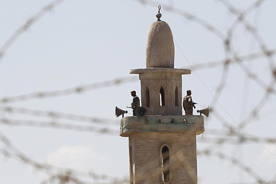 Egyptian soldiers stood guard on top of a minaret in the border town of Rafah. The military made a push in the northern Sinai.