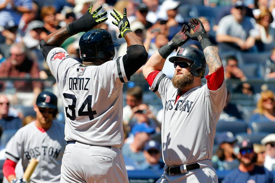 David Ortiz greets Mike Napoli following his tworun homer in the second.