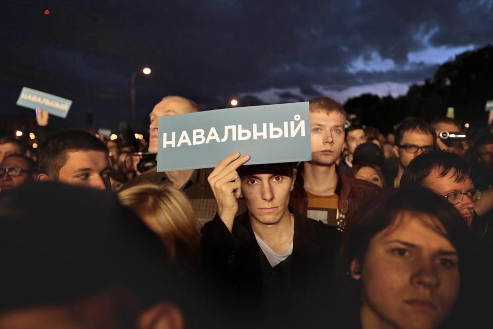 "Supporters held banners that read ""Navalny"" at a rally for Russian opposition leader Alexei Navalny in Moscow."