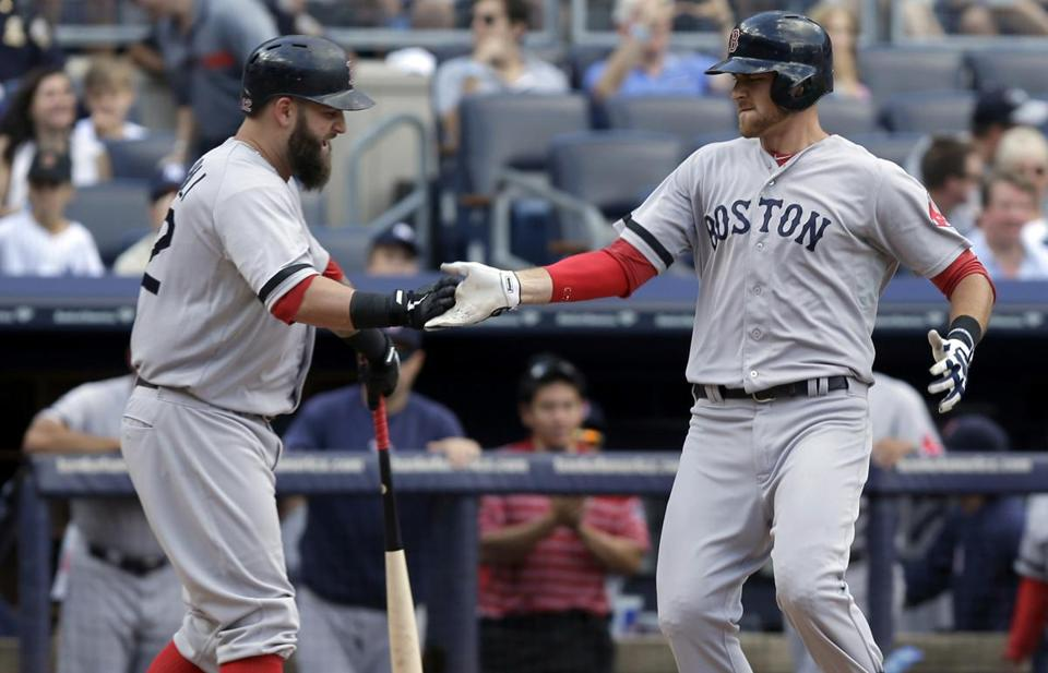 Will Middlebrooks, right, was greeted by teammate Mike Napoli after hitting a home run in the ninth inning Sunday.