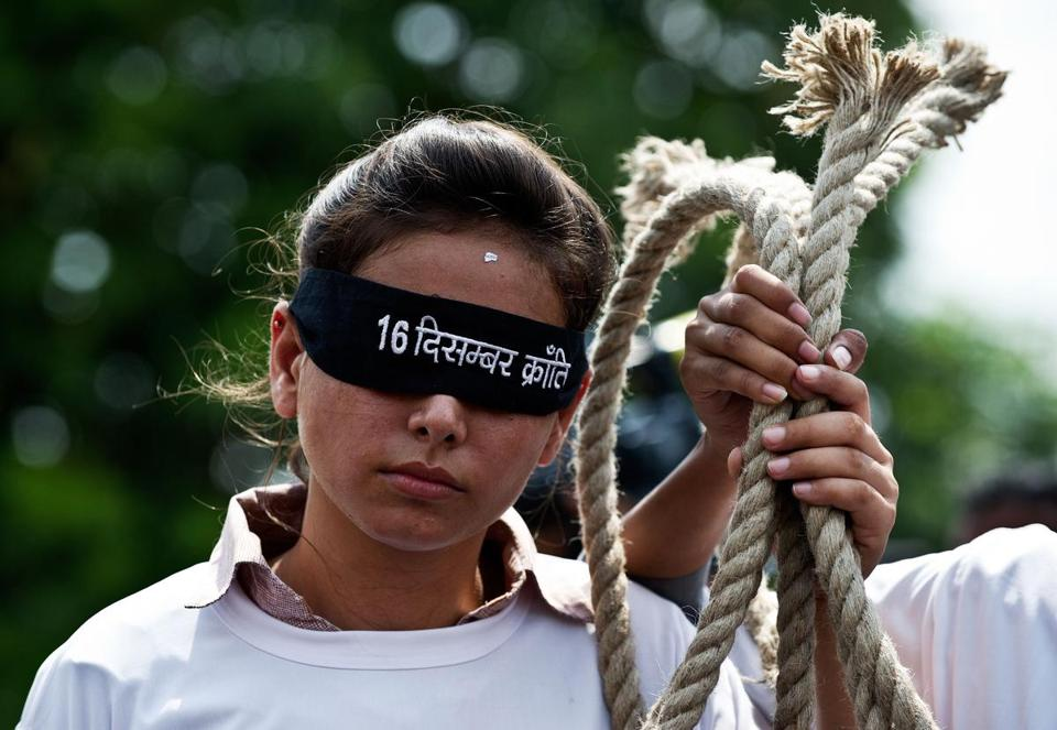 Demonstrators protested outside the Saket Court complex in New Delhi, calling for the hanging of the convicted rapists.