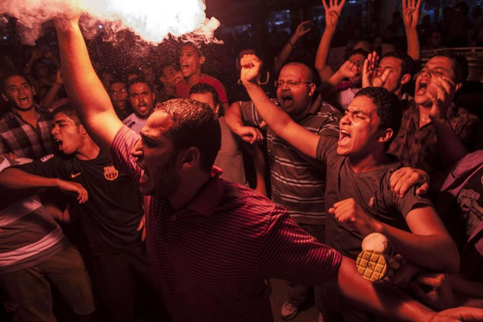 Muslim Brotherhood members lighted flares in a protest against Egypt's military-backed leaders in Cairo on Tuesday.