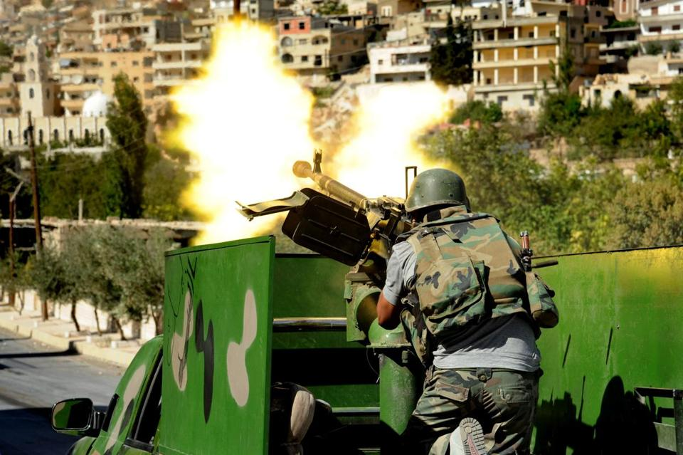 A Syrian soldier fired a machine gun on Saturday during clashes with rebels in Maaloula, northeast of Damascus.