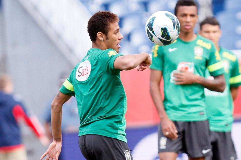 Brazil's Neymar juggles the ball during practice for Tuesday night's match vs. Portugal.