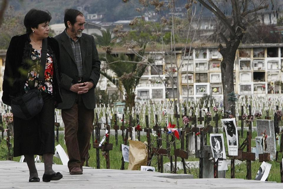 Two people passed the Patio 29 at General Cemetery in Santiago, where most of the graves of victims of the dictatorship of Augusto Pinochet were hidden.
