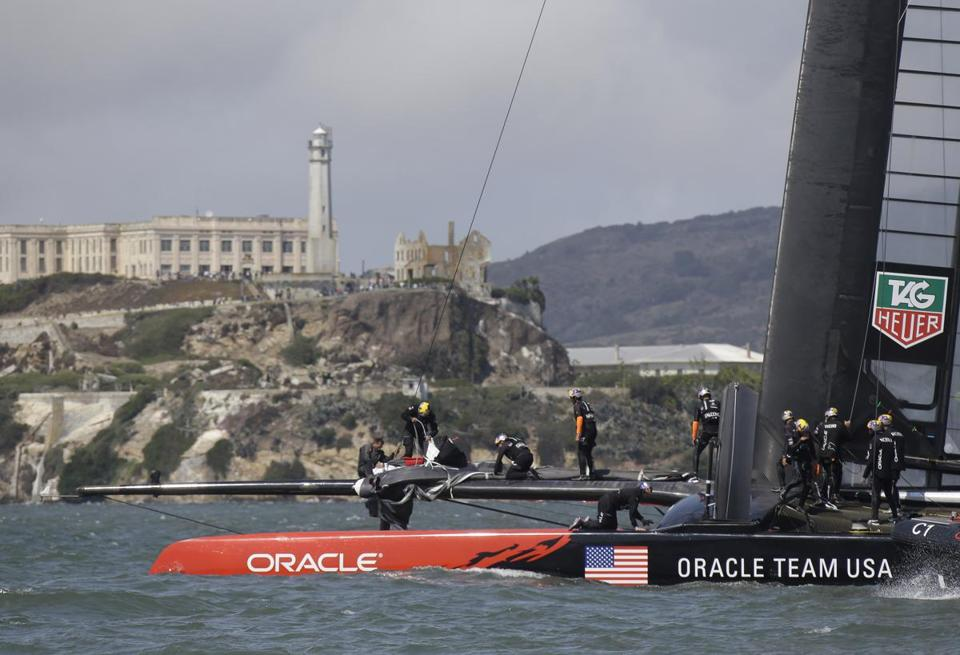 Oracle Team USA, sailing by Alcatraz island, was beaten so soundly they postponed Wednesday's race to regroup.