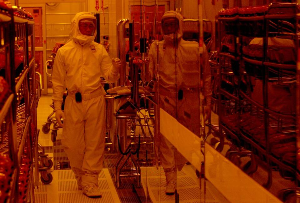A manufacturing technician worked in the clean room at the Intel factory in Hudson in 2004.