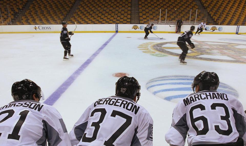 The new No. 2 line — Loui Eriksson, Patrice Bergeron, Brad Marchand — watches practice.