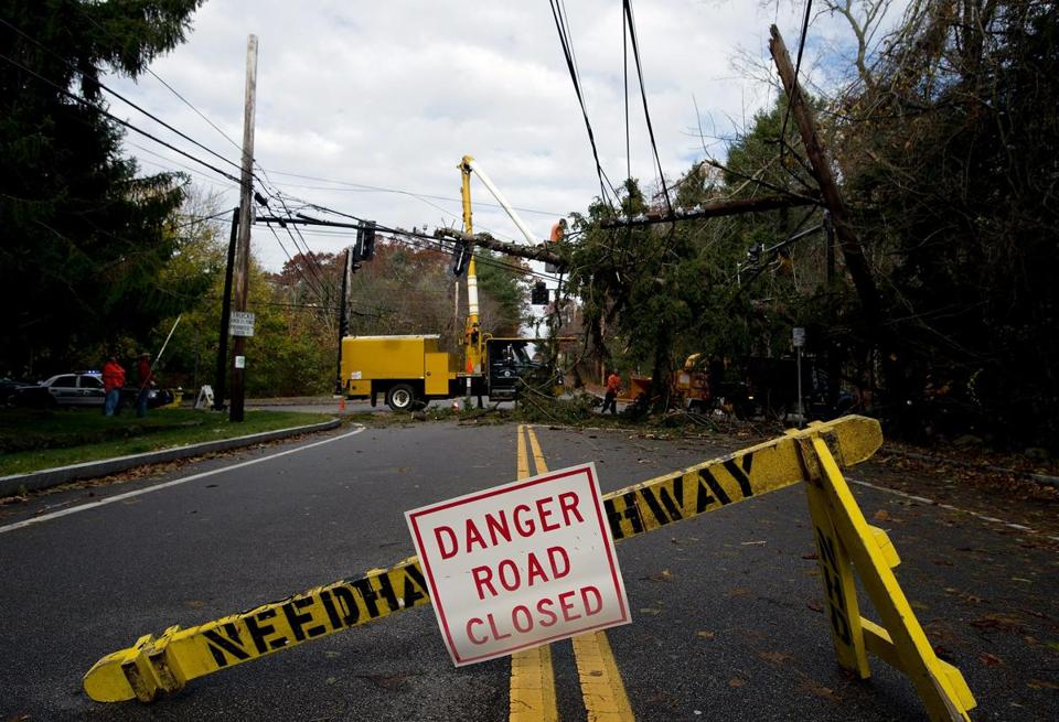 Needham public works crews removed a tree from power lines and traffic lights after Hurricane Sandy passed through last year.