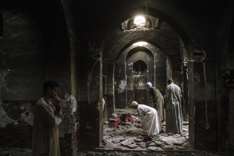 Villagers cleaned an ancient chapel in a monastery that had been looted and burned by Islamists in Dalga.