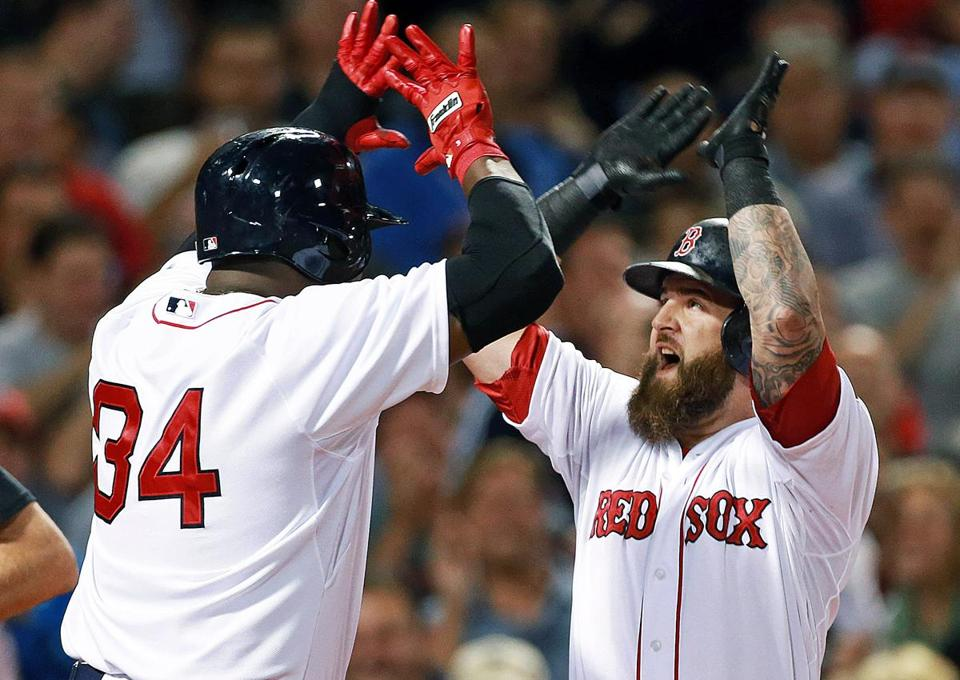 Mike Napoli was met at the plate by David Ortiz after his two-run home run in the first inning.