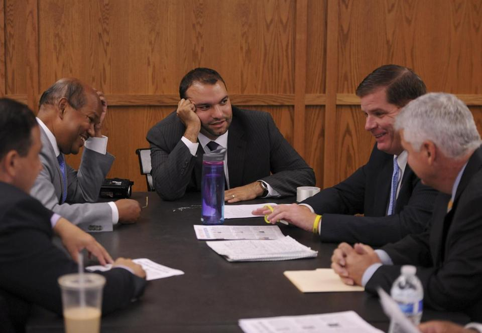 Mayoral hopefuls Rob Consalvo, Charles Yancey, Felix Arroyo, Martin Walsh, and Daniel Conley shared a laugh before a candidates' forum last week.