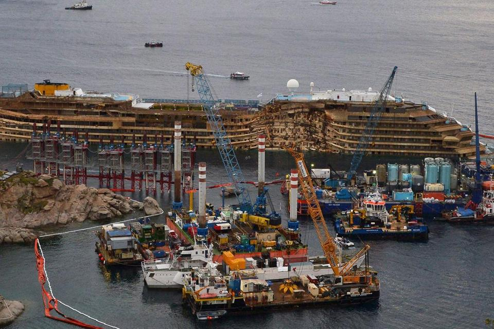 The Costa Concordia was turned upright in what officials called the biggest-ever salvage operation of a passenger ship.