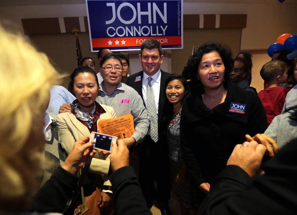 John Connolly posed for a photo with supporters after speaking during a rallyin West Roxbury on Tuesday.