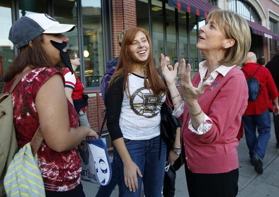 Martha Coakley chatted with Berklee students Angelica Franzino (left) and Carly Tefft while campaigning outside Fenway Park, which had become emblematic of her failed US Senate run.