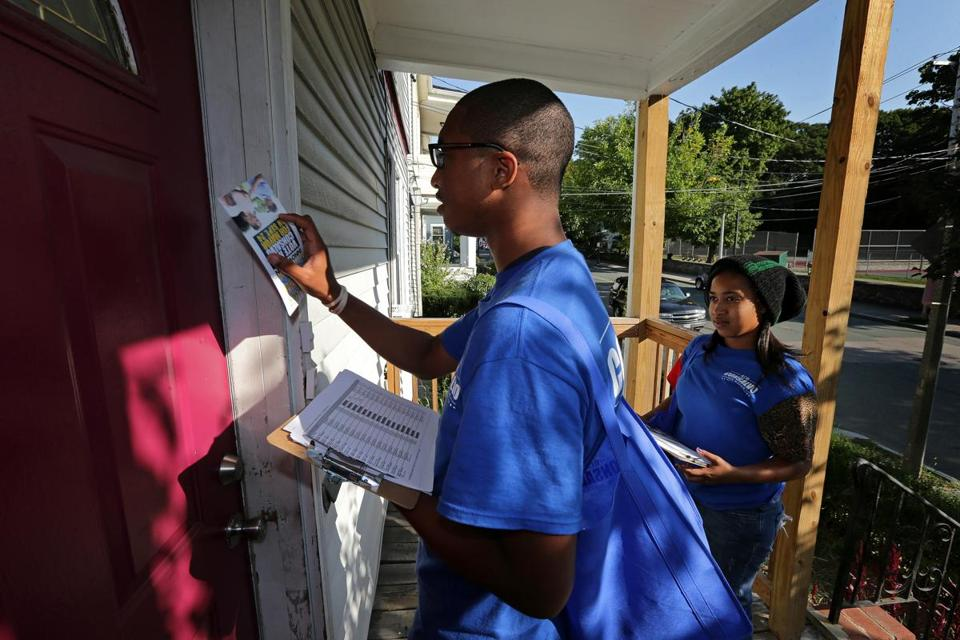 Jalen Wiggins (left), 19, and Ariel Champagnie, 24, knocked on doors for their candidate Tuesday in Mattapan.