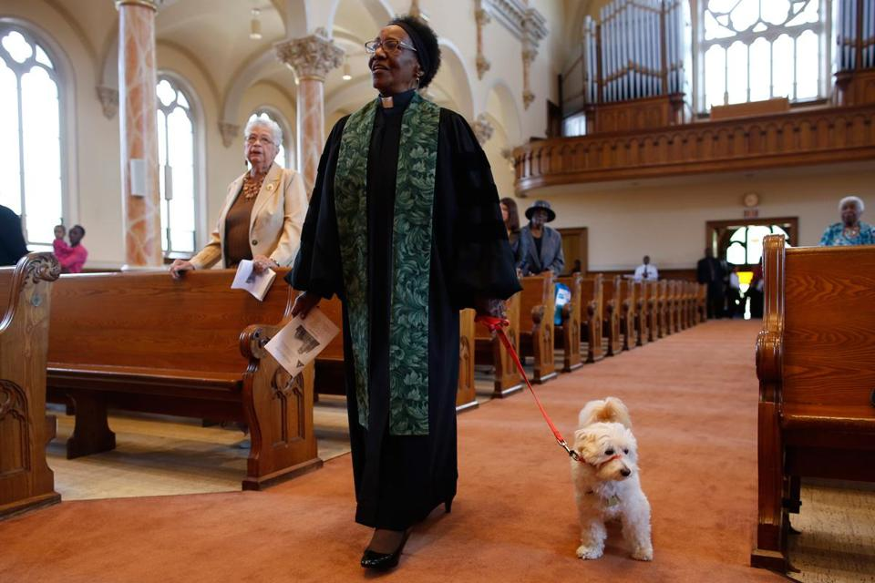 Celestine Reid, associate minister at Belmont A.M.E. Zion Church in Worcester, is assisted by a service dog due to her hearing impairment.