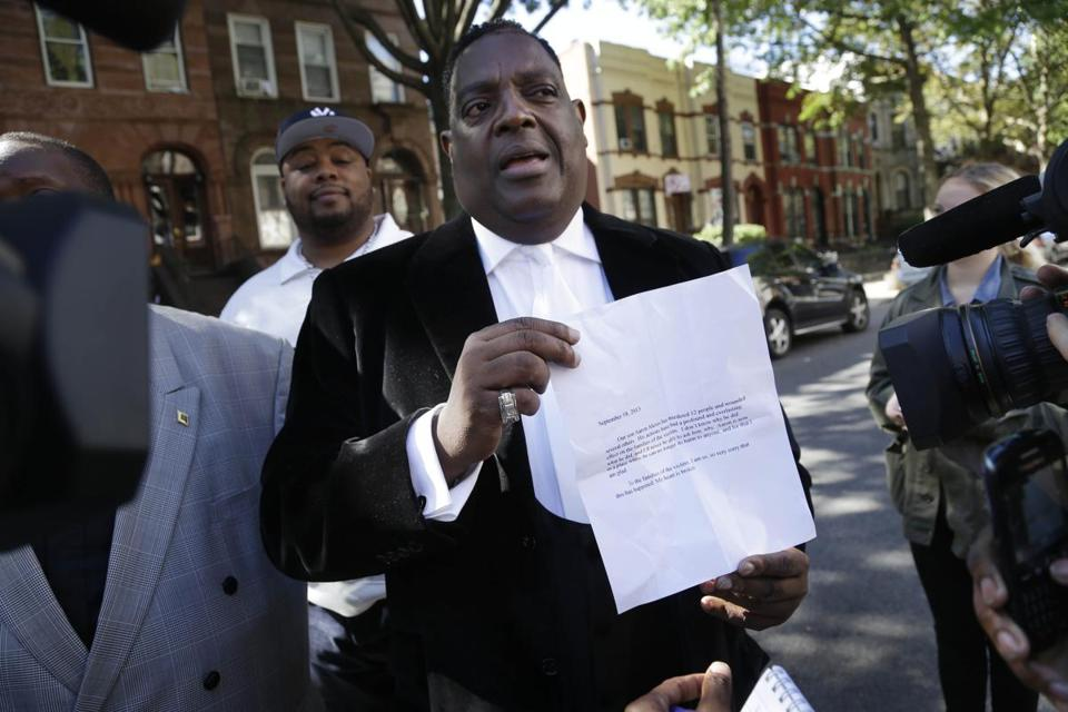 Bishop Gerald Seabrooks showed a statement made by Cathleen Alexis, mother of Washington Navy Yard gunman Aaron Alexis, in Brooklyn on Wednesday.
