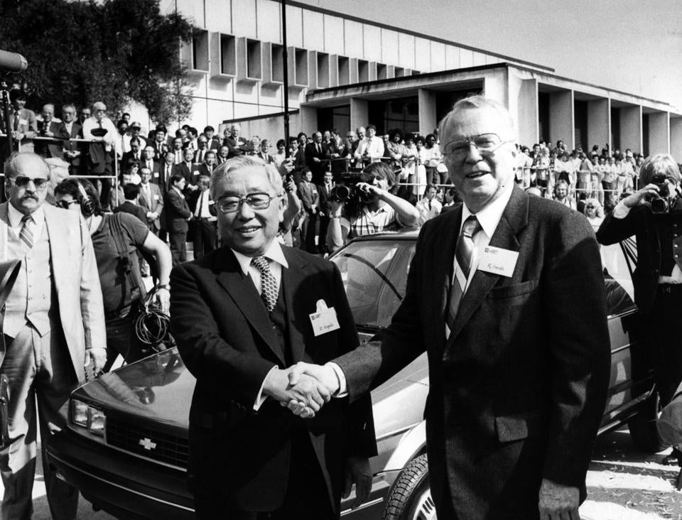 Eiji Toyoda and GM chairman Roger B. Smith with a jointly produced Chevy Nova in 1985.