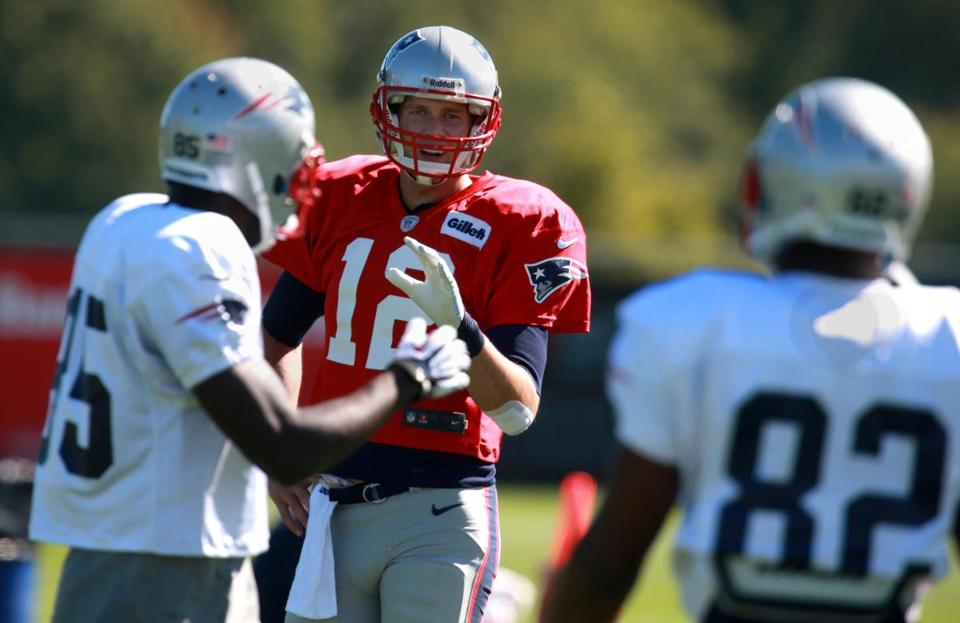 Tom Brady yelled out to Kenbrell Thompkins, left, and Josh Boyce during Wednesday's practice.