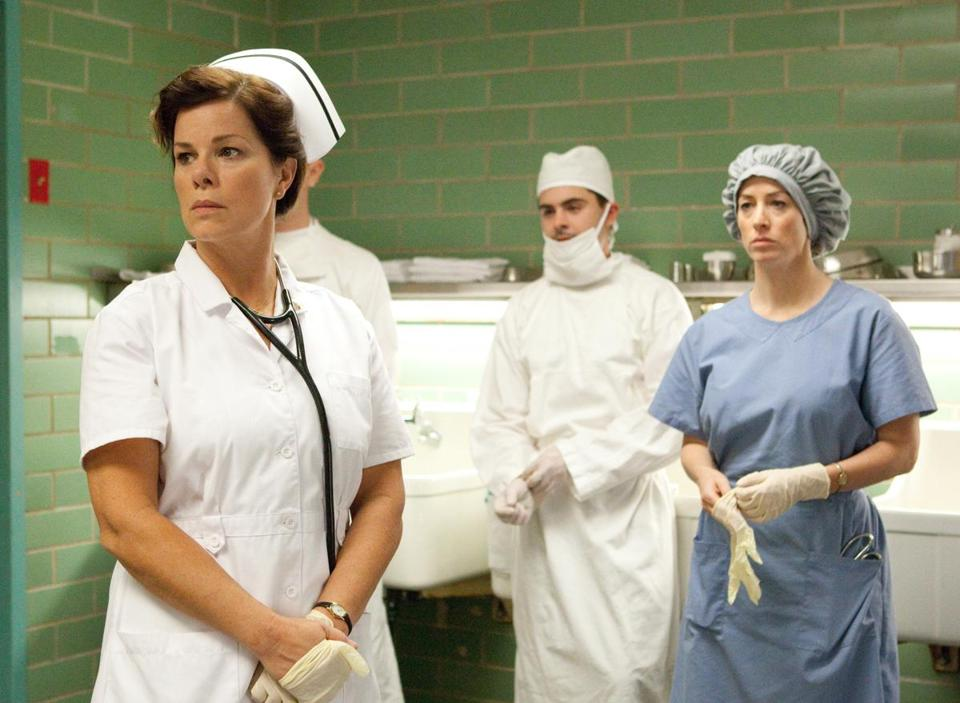 "In ""Parkland"": (above, from left) Marcia Gay Harden, Zac Efron, Aidan Sullivan, and (left) Paul Giamatti."