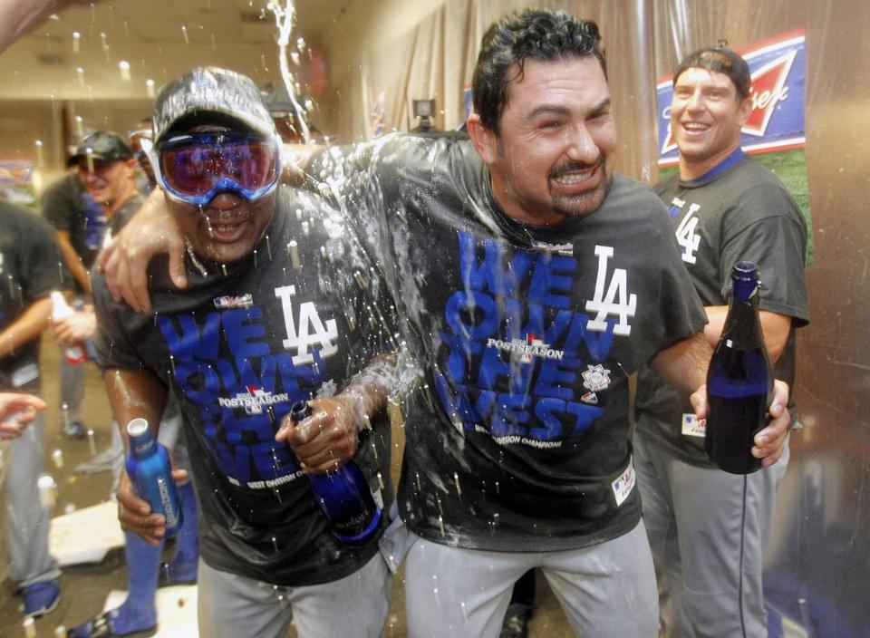 Adrian Gonzalez (second from right) and his teammates celebrated Thursday after locking up the NL West crown.