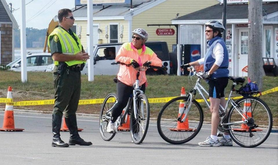 A Hampton, N.H., police officer directed bicyclists to a detour after the fatal accident.
