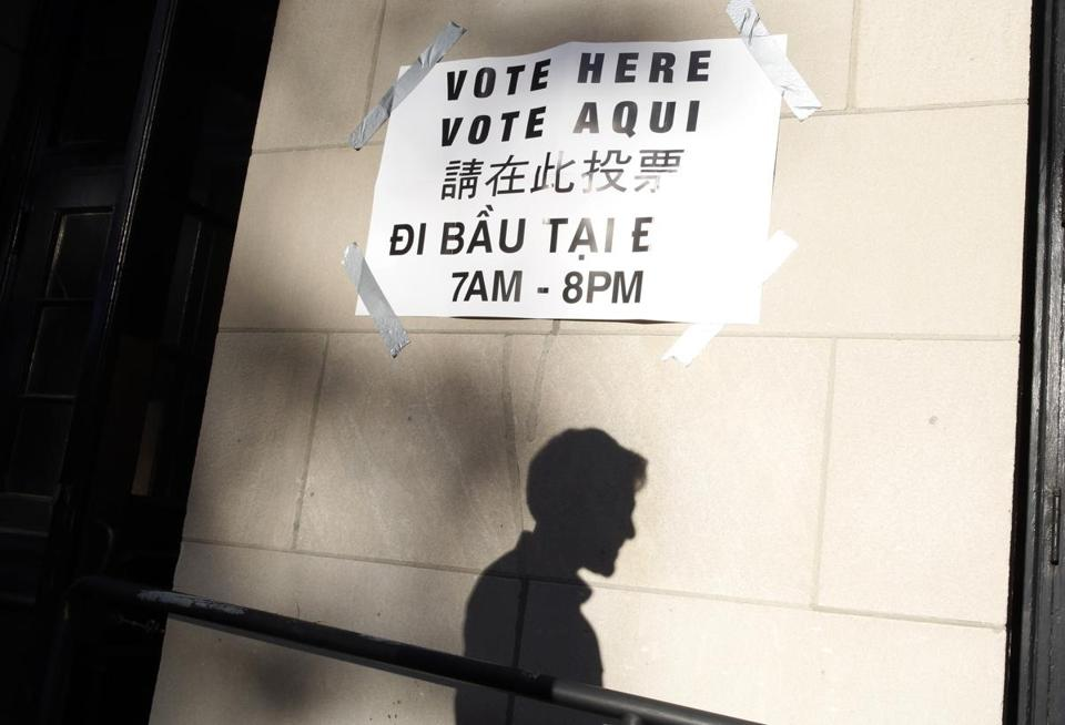 A multilingual sign greeted voters at the Benjamin Franklin Institute of Technology on Tuesday.