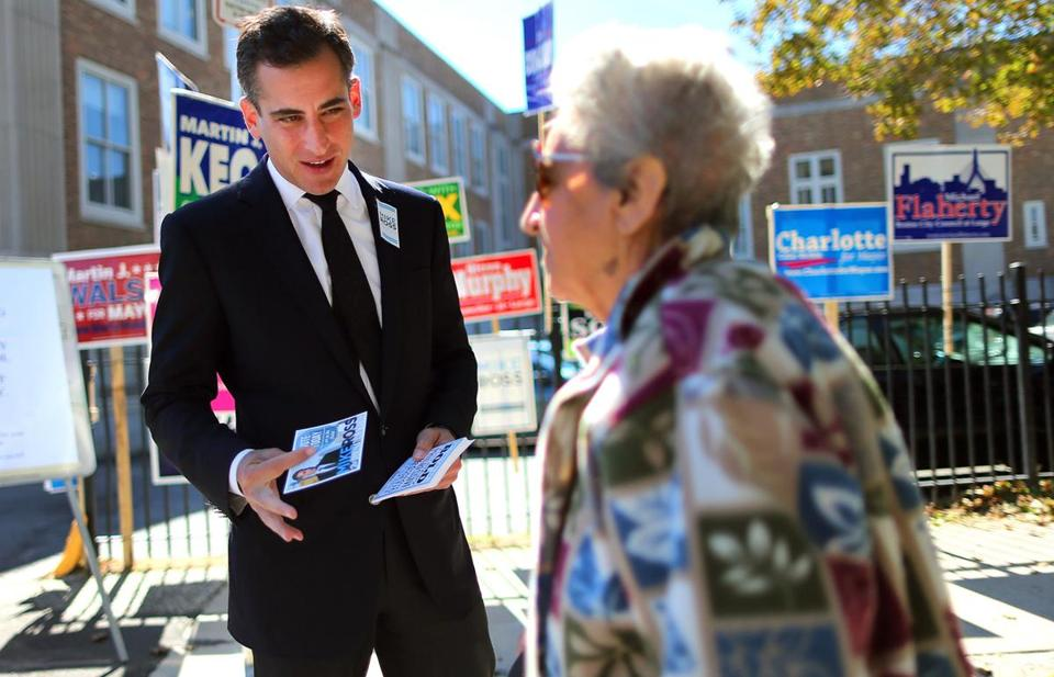 Mike Ross greeted Bessie Kotsakis before she voted in Jamaica Plain. He gave up his job as city councilor to run for mayor.