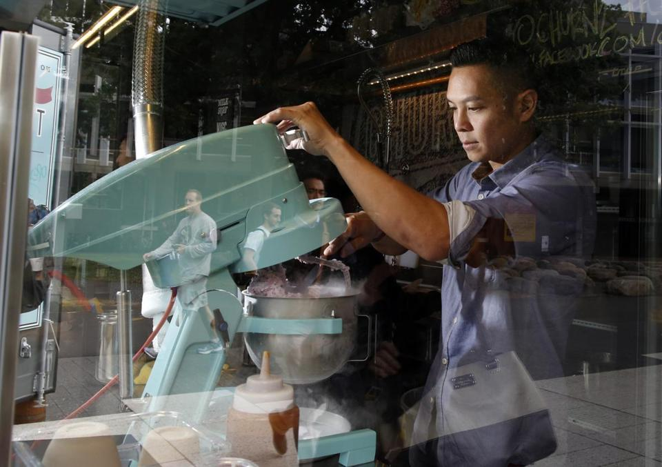 Ash Chan, owner of Churn2, makes ice cream using liquid nitrogen at his shop in Cambridge.