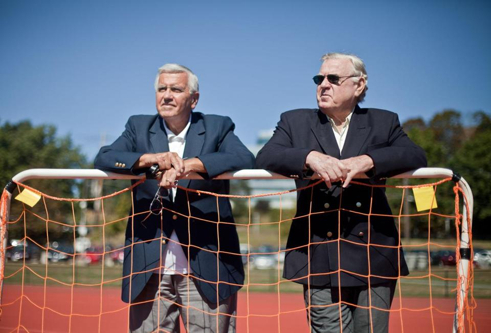Former Brandeis players Dick Baldacci (left) and Mike Long revisiting the site of the school's football field, long since converted for soccer.