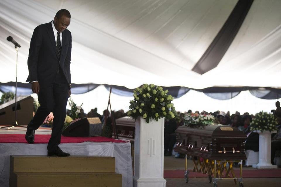 President Uhuru Kenyatta of Kenya passed his nephew's coffin at a service for several victims of the Nairobi mall attack.