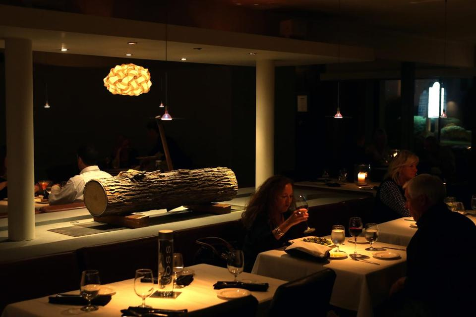 The sleek dining room at Ember is carefully designed and beautifully lighted.