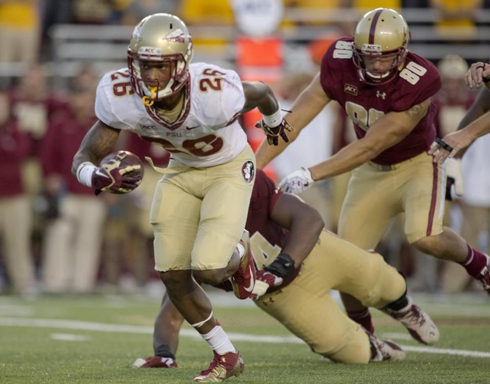 Florida State's P.J. Williams returned an interception during the second half of Saturday's game against Boston College.