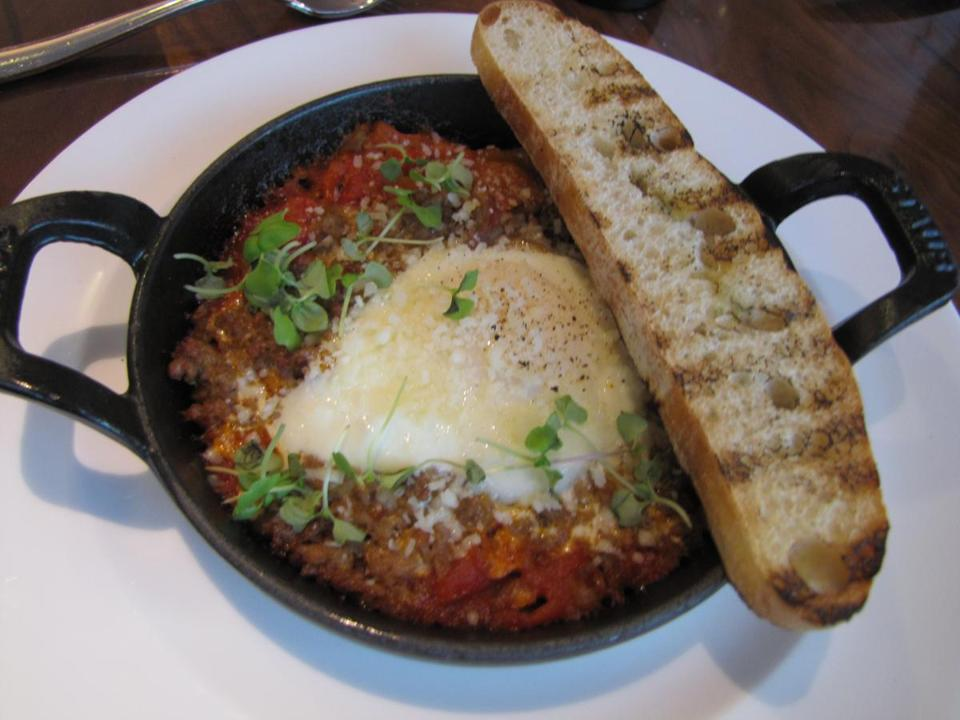 In the lobby of the Conrad Hotel, Atrio serves Mediterranean breakfast foods such as  these stone-oven-baked eggs.