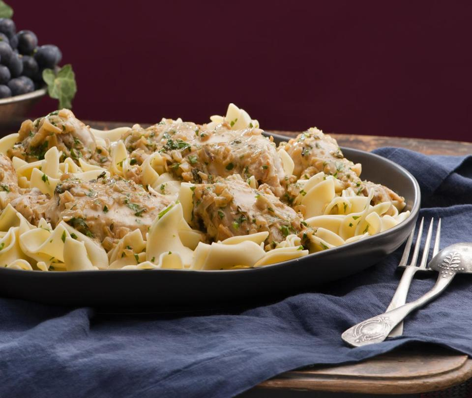 Chicken made with Riesling and served on egg noodles is a hearty fall choice.