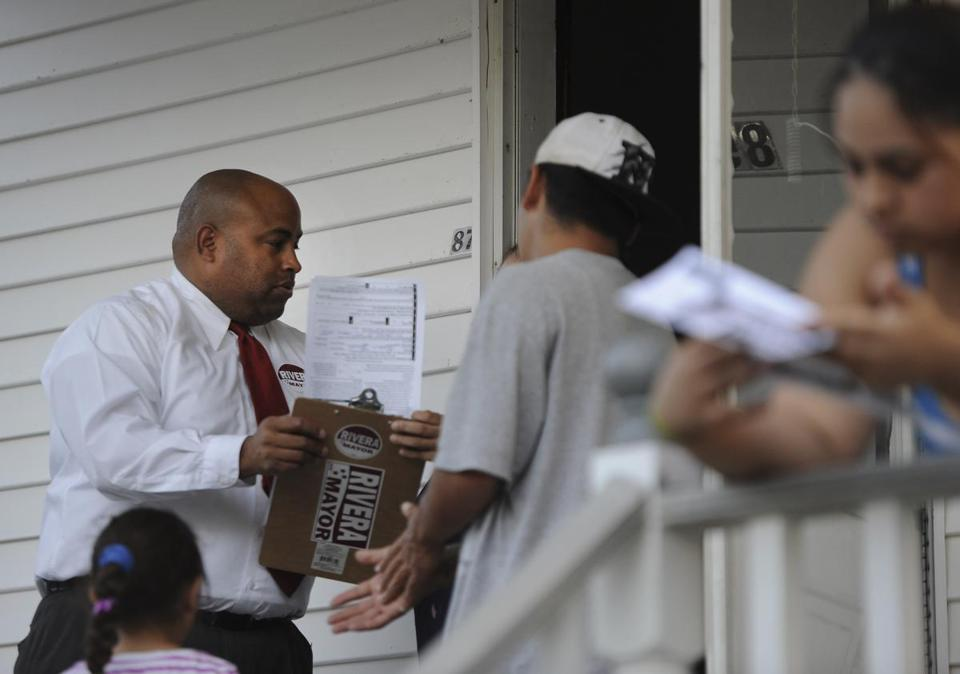 Councilor Daniel Rivera, the challenger in next month's Lawrence mayoral election, went door-to-door to try to secure votes, visiting the Abreu family.