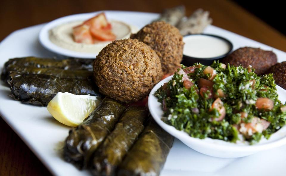Falafel, meat and vegetable-stuffed grape leaves, stuffed cabbage, kibbe balls, homemade hummus, and taboule.