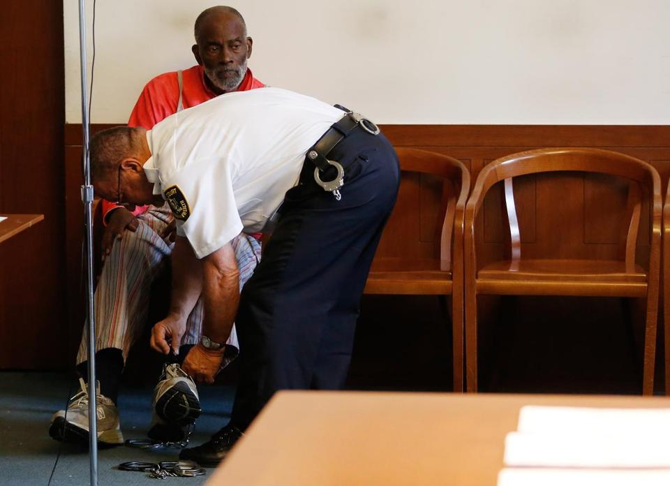 A court officer unshackled Mel King after he was arraigned.