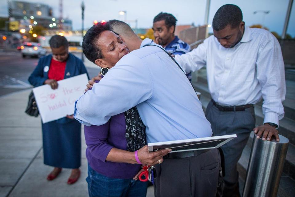 Isaura Mendes was comforted by friend James Hills  Thursday after the death of her nephew Leroy Carvalho the day before. In years past, she lost two of her sons to street violence.