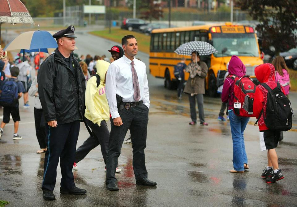 Officers at the Galvin Middle School, Ted Lehan (left) and Chuck Rae, monitor the school dismissal.