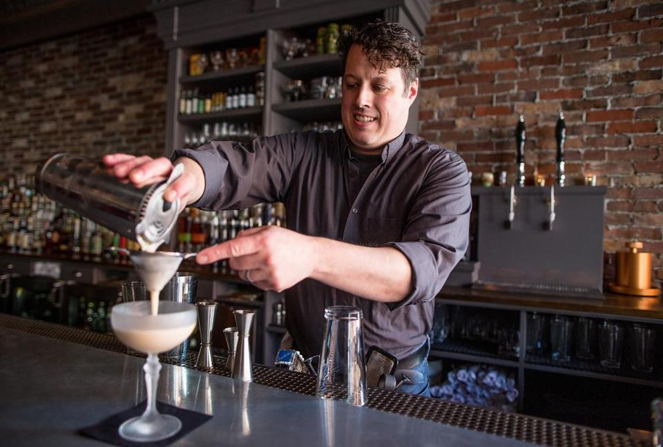 Co-owner and bartender Sean Maher of Barrel House American Bar in Beverly poured the Jersey Roots cocktail.