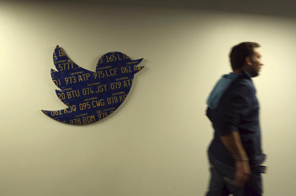 An employee walked past a Twitter logo at the company's headquarters in San Francisco Friday. When Twitter goes public, Spark Capital's holdings could be worth $640 million.