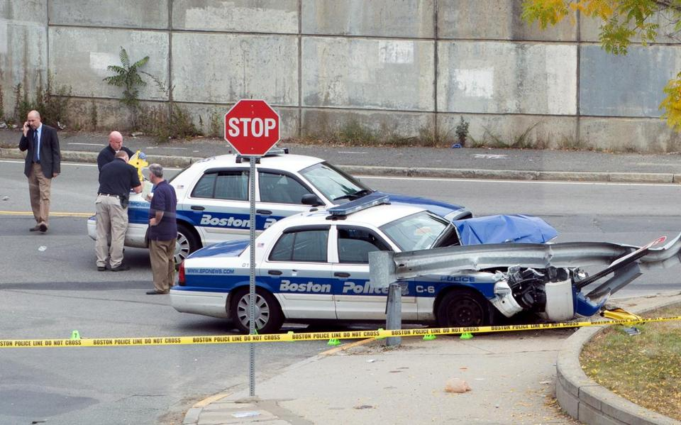 A Boston police cruiser was shown early Saturday in Dorchester at the JFK/UMass T stop, after the incident.