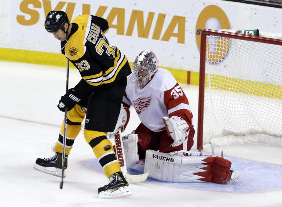 Zdeno Chara, who screened Red Wings goalie Jimmy Howard during last week's game, said the Bruins need to be a bit more aggressive in front of the opponent's net.
