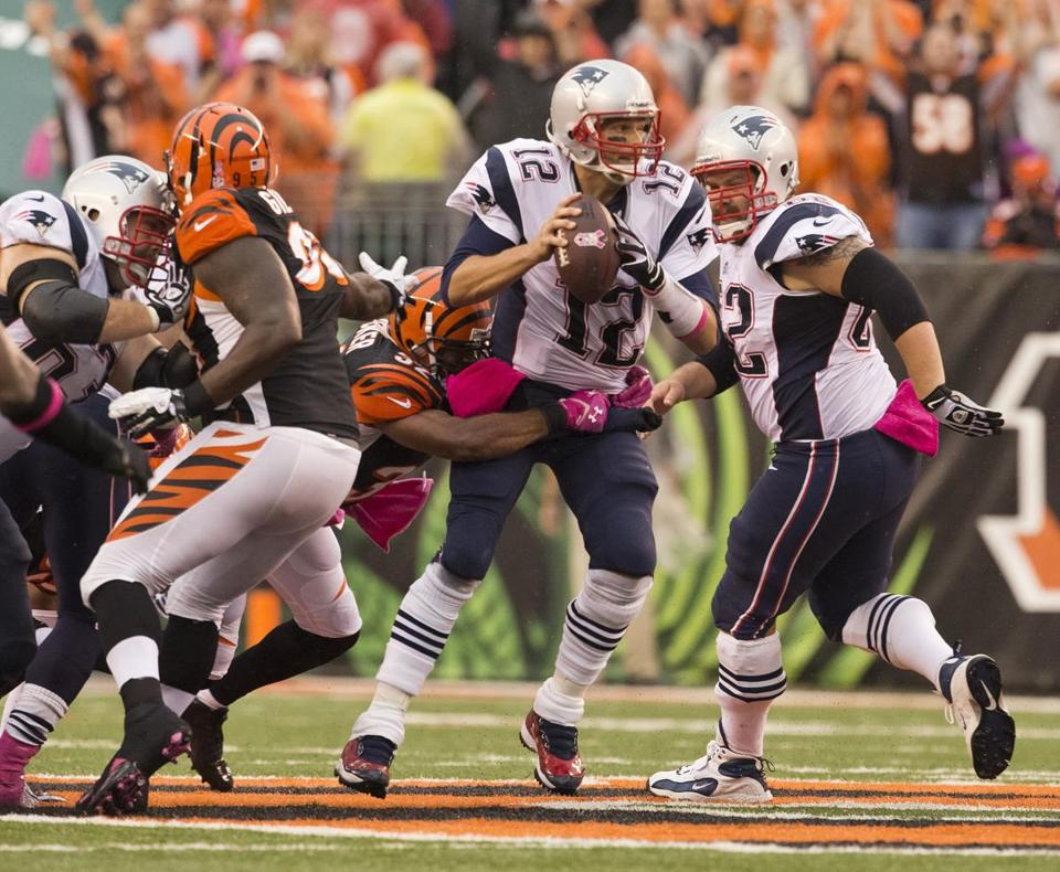 Tom Brady is wrapped up by the Bengals' Chris Crocker in the fourth quarter, one of four Cincinnati sacks on the day.