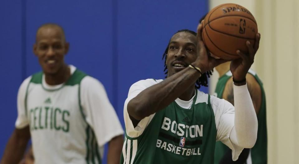 Boston Celtics forward Gerald Wallace sets to shoot during training camp at Salve Regina University on Wednesday.