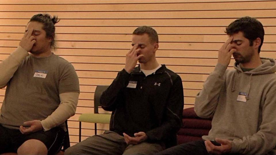 "From left: Veterans Stephen Lee, Bryan Dunker, and Rich Low try to quiet their troubled minds in Phie Ambo's documentary ""Free the Mind."""